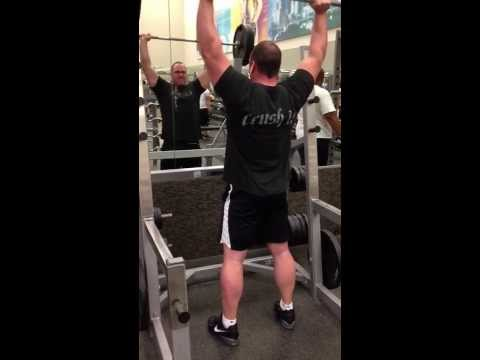 Standing Barbell Military Press - 3 reps @ 235lbs