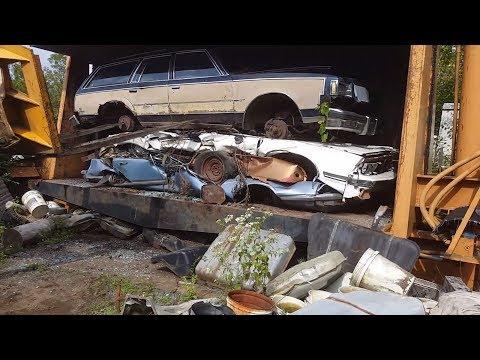 car crusher crushing cars 47 1969 Buick riviera