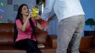 Young excited woman getting surprise gifts from her boyfriend on Valentine's Day