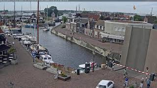 Preview of stream Cyclers and a drawbridge in Lemmer, the Netherlands