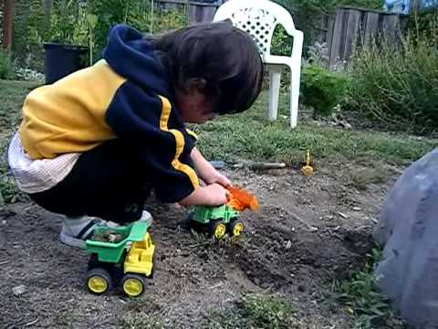 Kid Plays With Toy Diggers In Dirt At Grandmas Youtube