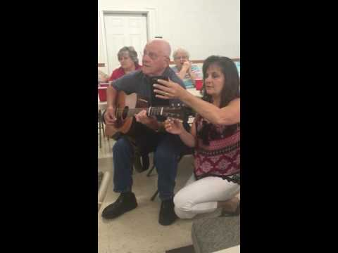 Melvin singing a song at the family reunion