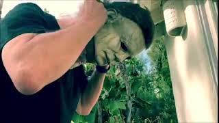 Nick Castle putting on his Michael Myers HALLOWEEN (2018) mask