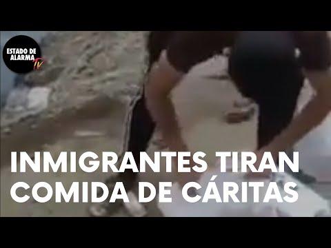 Así TIRAN la COMIDA de CÁRITAS unos INMIGRANTES