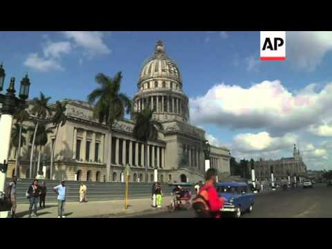 A Cuban man has managed to filter through Havana's chaotic downtown traffic and enjoy rare views of