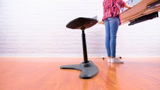 the e7 stool allows you to perch on a supportive seat at your sitstand workstation
