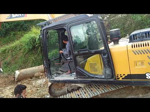 Construction With Teen Driver On Muddy Road  Himalaya.