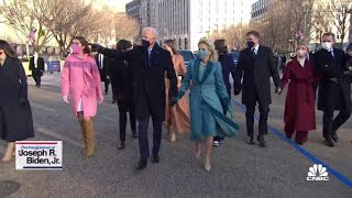 President Joe Biden walks toward the White House