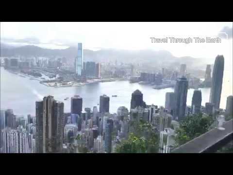 Hong Kong after dawn awakes the slumbering masses huddled in the cold steel canyons down below