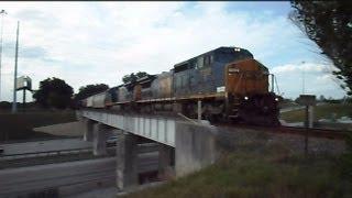 CSX Train Over A Bridge And Through A Crossing To The Railroad Yard We Go