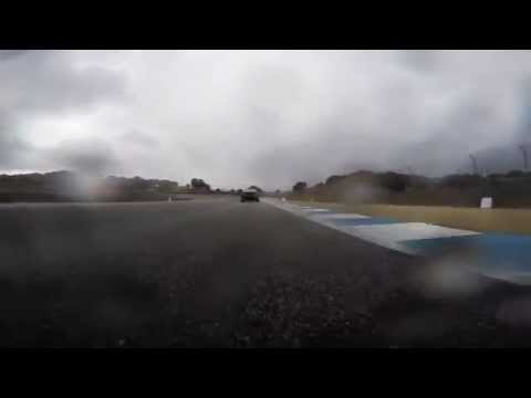 Nissan GTR POV at Laguna Seca - Pull on Lotus and MP3 on a wet track