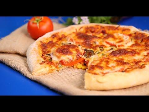 صورة  طريقة عمل البيتزا طريقة عمل بيتزا محشية الاطراف بالجبنة طريقة عمل البيتزا من يوتيوب