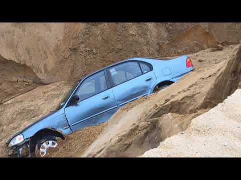 Car falls into Cape Cod sand dune after it collapses