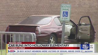 Video: Car hits school