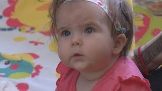 Baby hears for the first time thanks to cochlear implants