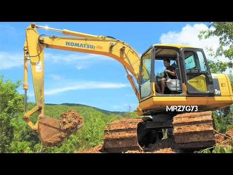 Komatsu PC130F Digging Cutting Dirt Into Dump Truck