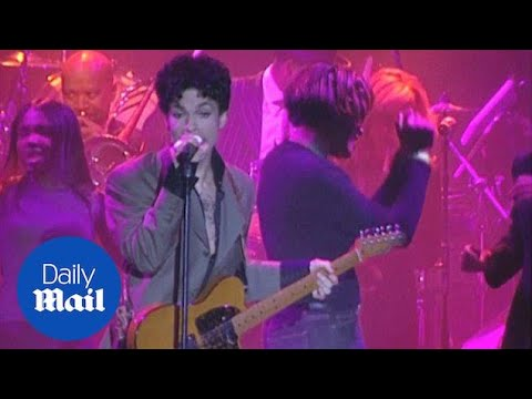 Prince performs his hit Kiss on stage in 2004 - Daily Mail