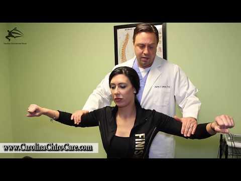 Dancer Receives Chiropractic Adjustment By Chiropractor In Raleigh NC