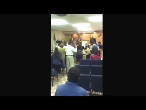 Reverend Elmer Cayas preaching at concilio Pentecostal ebenezer