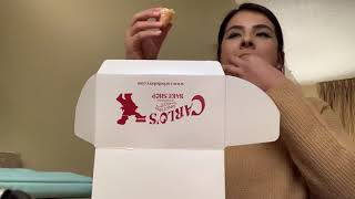 Eating a lobster tail pastry from Carlo's Bakery