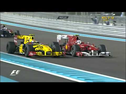 Alonso waving Petrov in Abu Dhabi 2010