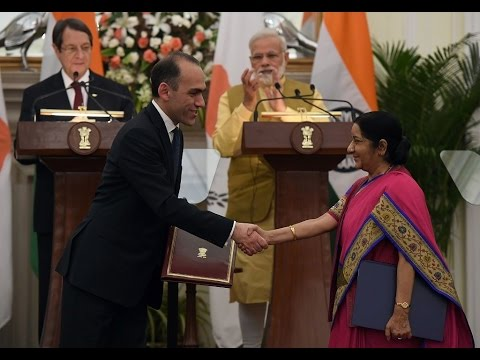 Cyprus Finance Minister exchanges an agreement with India External Affairs Minister