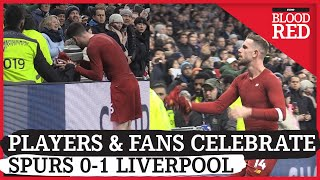 Liverpool players celebrate with fans after 1-0 win against Tottenham Hotspur