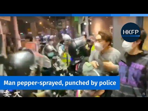 Hong Kong police pepper-spray and punch young man
