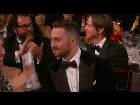Tom Ford kisses Aaron TaylorJohnson on the neck  backstage   Golden Globes Awards 2017
