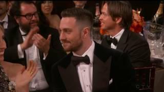 tom ford kisses aaron taylor johnson on the neck backstage golden globes awards 2017