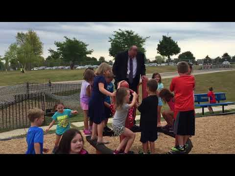 Dr. Onsager spends time with student at recess