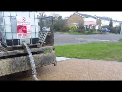 Keston services installing a resin bound stone drive on top of a permeable concrete base