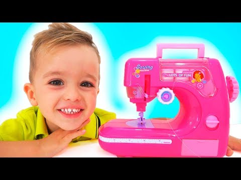 Vlad and Mommy playing with Toy Sewing machine