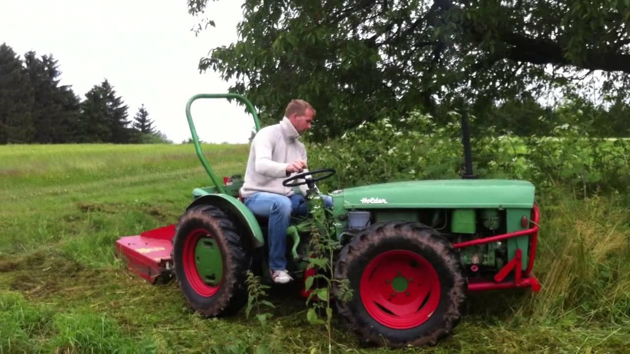 Holder AG35 mit Mulcher Knicklenker Traktor mulcht Hochgras Schmalspurschlepper Schlepper - YouTube