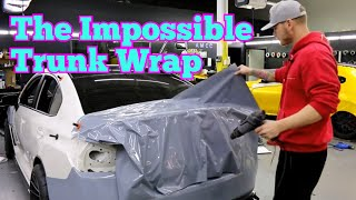 How do you get rid of all of the excess film when wrapping a trunk?...