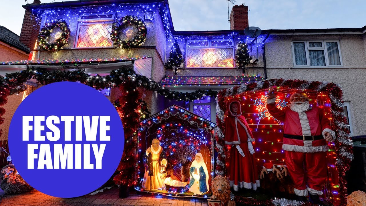 festive mad family put up christmas decorations 60 days early