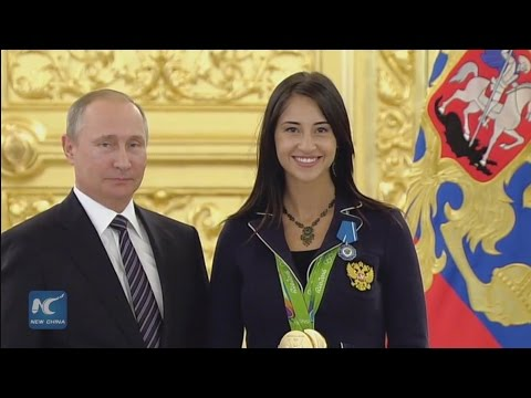 """Putin gives credit to Russian Olympic team for """"worthy"""" performance"""