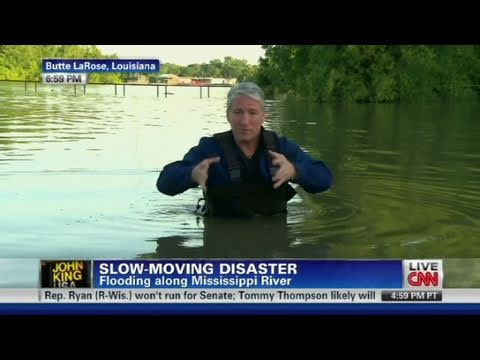 CNN anchor stands chest deep in water