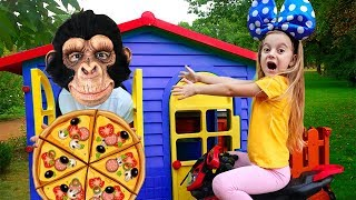 Girl and monkey play with food House