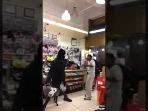 Man fights dude with a dog leash in store