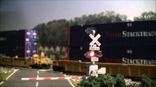 Intermodal train at crossing in HO scale