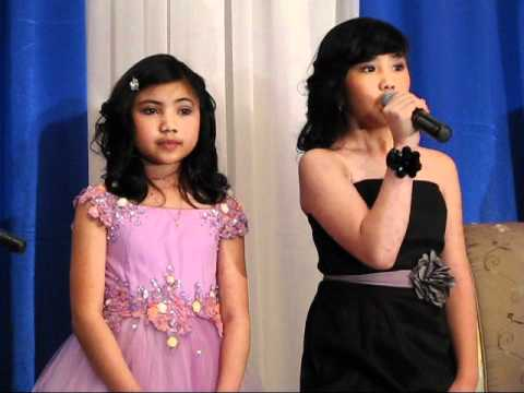 """""""O Canada"""" as Sung in English and French by Two Filipino Talents"""