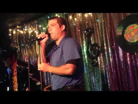 Justin singing Piano Man with harmonica (karaoke)