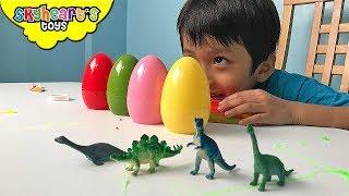 DINOSAURS IN SLIME EGGS! What's inside the surprise eggs? dinosaur toys for kids slime trex raptor