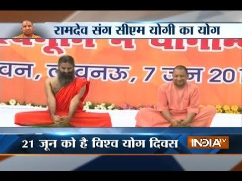 CM Yogi Adityanath practices yoga with Baba Ramdev ahead of International Yoga Day