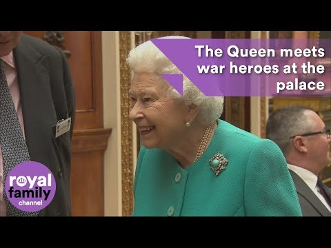 The Queen meets war heroes at Buckingham Palace