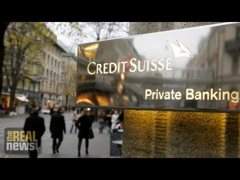 New Law Requires Swiss Banks to Report Customers Evading Tax