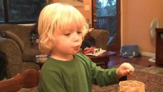"Reid ""making"" Peanut Butter Bird Feeder"