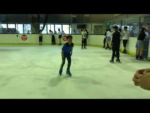 Sit Spin competition with a young boy in Hong Kong!