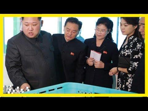 Kim jong-un and wife visit pyongyang cosmetics factory